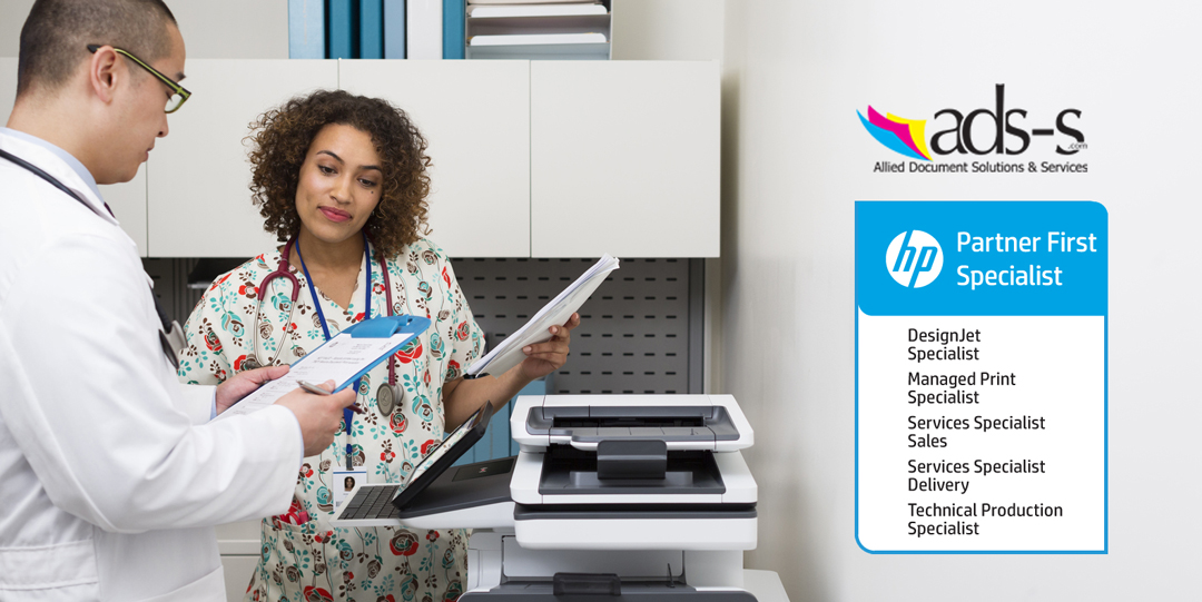 Doctor and nurse discussing hospital charts printed with a HP PageWide Enterprise Color MFP 586z.